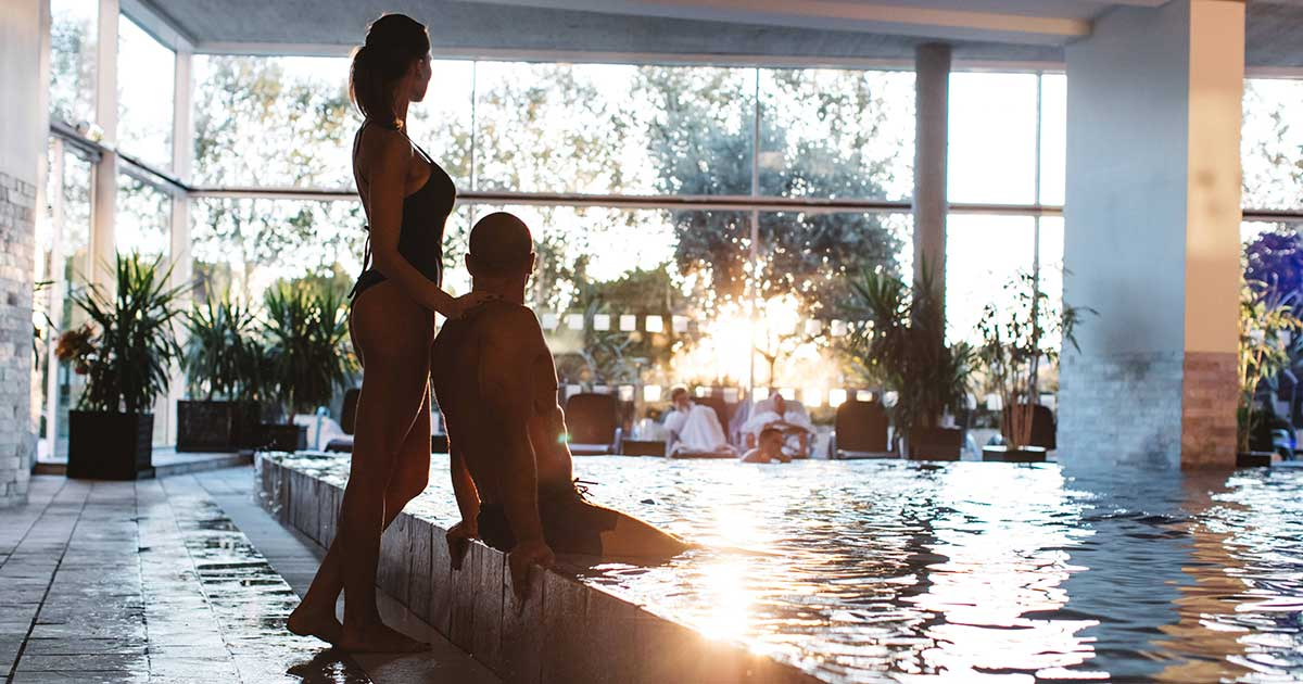 Couple in ayush spa pool