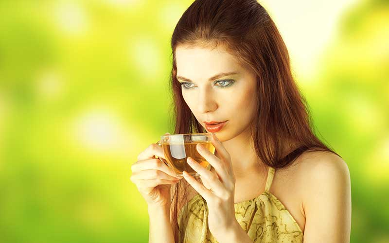Girl drinking herbal tea