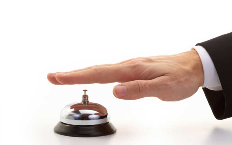 Hand on reception bell