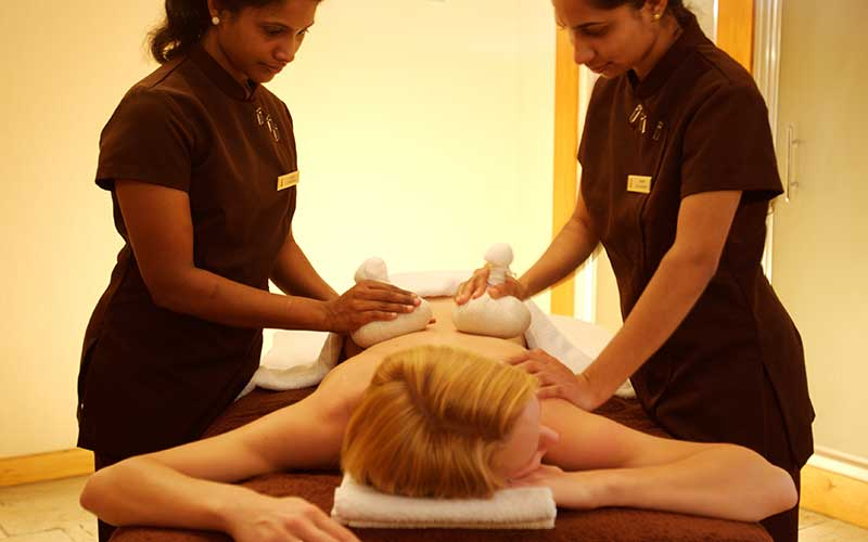 Two therapists giving massage