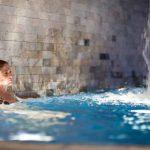girl relaxing in spa pool
